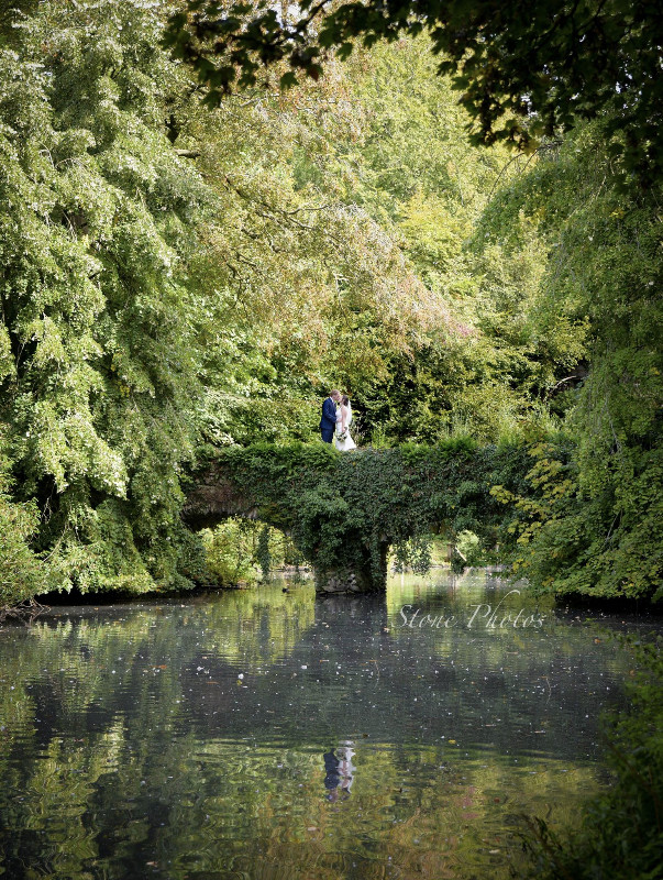 busbridge-lakes-wedding-reception-event-venue-gardens-in-surrey-couple-canal-lake-stone-bridge-credit-stone-photos-wm