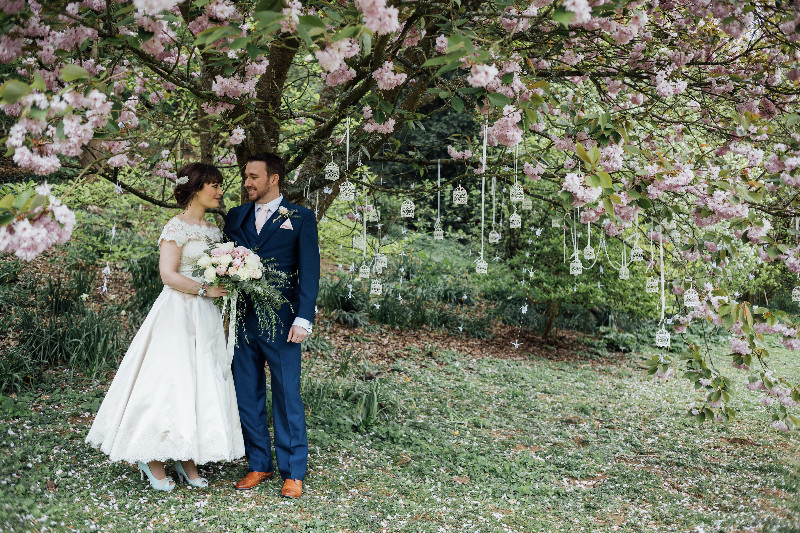 busbridge-lakes-wedding-reception-event-venue-gardens-in-surrey-couple-cherry-blossom-credit-charlotte-bryer-ash