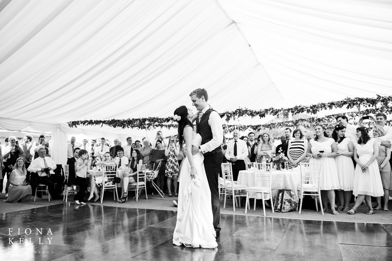 busbridge-lakes-wedding-reception-event-venue-gardens-in-surrey-couple-marquee-interior-dancing-credit-fiona-kelly-photography-wm