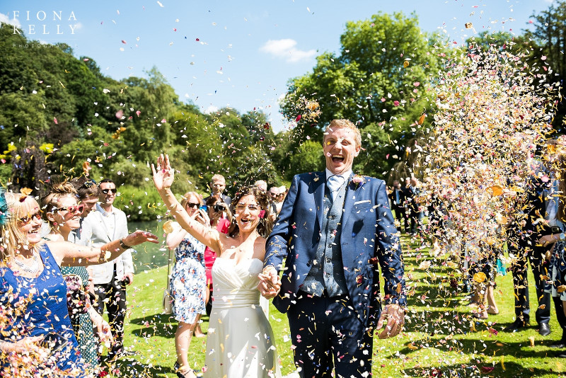 busbridge-lakes-wedding-reception-event-venue-gardens-in-surrey-reception-lawn-confetti-line-credit-fiona-kelly-photography-wm