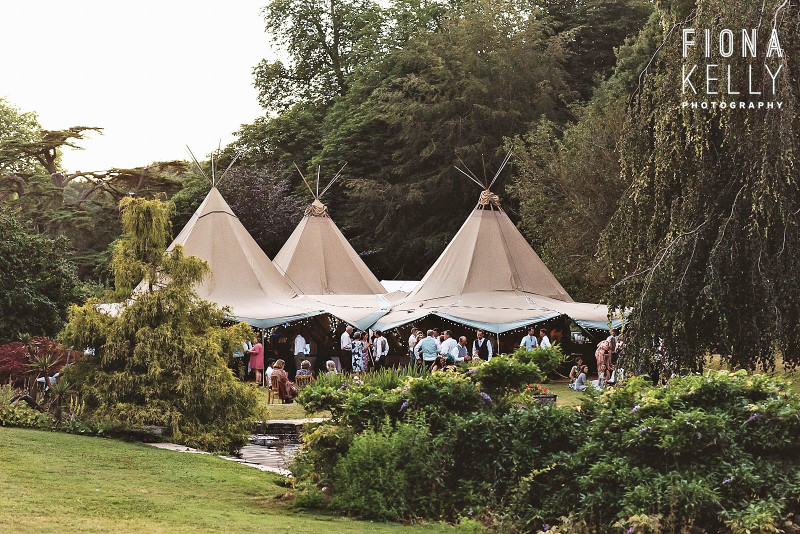 busbridge-lakes-wedding-reception-event-venue-gardens-in-surrey-tipi-3-hat-exterior-credit-fiona-kelly-photography-wm