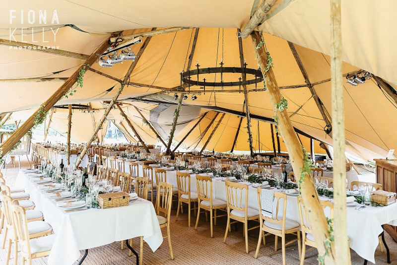 busbridge-lakes-wedding-reception-event-venue-gardens-in-surrey-tipi-interior-minimalistic-credit-fiona-kelly-photography-wm